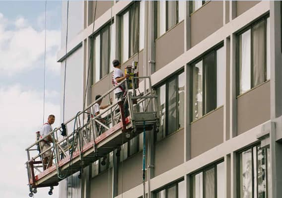 Exterior Painting with Painter on Platform